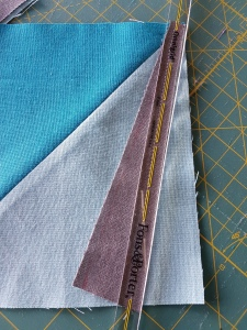 Remember to trim the extra piece you have now off before pressing seams open.